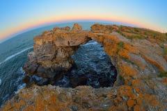 Sunset rocks on beach in Tyulenovo, Bulgaria Stock Images