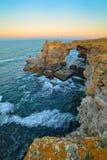Sunset rocks on beach in Tyulenovo, Bulgaria Stock Photo