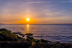 Sunset by the rocks Royalty Free Stock Photos