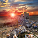 Sunset with rocks Stock Image