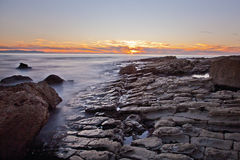 Sunset on the rocks of Rancho Palos Verdes, California. Evening sunset on the rocks of Rancho Palos Verdes, California near the Donald Trump Golf course Royalty Free Stock Image
