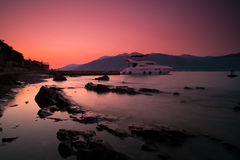 Sunset, Rocks, Sea And Yacht Royalty Free Stock Images