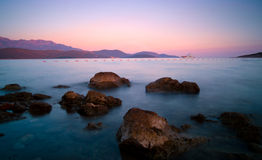 Sunset on rocky adriatic beach in Montenegro Royalty Free Stock Photography