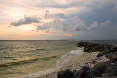 Sunset on the rocky beach Royalty Free Stock Photos