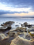 Sunset at rocky beach Royalty Free Stock Image