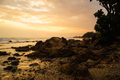 Sunset at the rocky beach Stock Photos