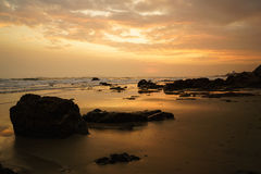 Sunset at the rocky beach Stock Photo