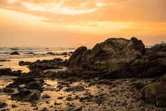 Sunset at the rocky beach Royalty Free Stock Image