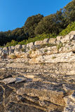 Sunset rocky beach in Istra, Croatia. Stock Photos