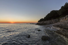 Sunset rocky beach in Istra, Croatia. Royalty Free Stock Photo
