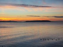 Sunset on the rocky beach in Sidney, Vancouver Island, British C Royalty Free Stock Photography