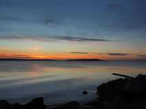 Sunset on the rocky beach in Sidney,  Vancouver Island, British Royalty Free Stock Photography