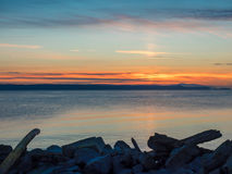 Sunset on the rocky beach in Sidney,  Vancouver Island, British Royalty Free Stock Image