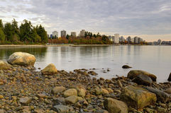 Sunset at a rocky beach, Stanley Park Royalty Free Stock Image