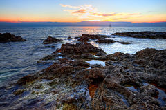 Sunset on the rocky coast of Black sea Royalty Free Stock Images