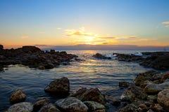 Sunset on the rocky coast of Black sea Stock Photo