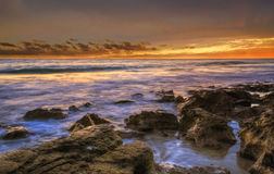 Sunset on a rocky coast. Line  Perth WA Royalty Free Stock Images