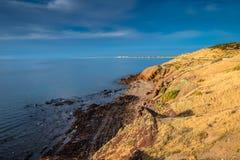 Sunset at rocky coast Stock Photo