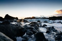 Sunset at rocky coast of Tenerife Stock Photo