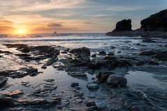 Sunset at a Rocky Cove Royalty Free Stock Image