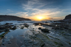 Sunset at a Rocky Cove Royalty Free Stock Photo