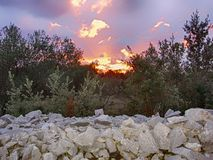 A sunset on a rocky hill royalty free stock photos