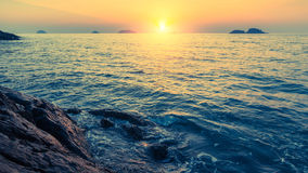 Sunset on rocky sea shores at islands. Nature. Stock Images
