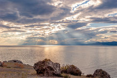Sunset on a rocky seashore. Sunset sky on the rocky coast of the Black Sea in Crimea Royalty Free Stock Photo