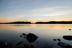 Sunset and rocky shore Royalty Free Stock Photography