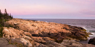 Sunset On Rocky Shore Stock Photo