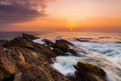 Sunset on the rocky shore Royalty Free Stock Photography