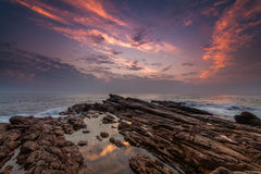 Sunset on the rocky shore Stock Photography
