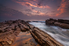Sunset on the rocky shore Royalty Free Stock Photo