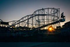 Sunset and rollercoaster in Daytona Beach, Florida. Stock Photos