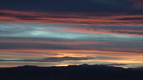 Sunset with rolling clouds stock video footage