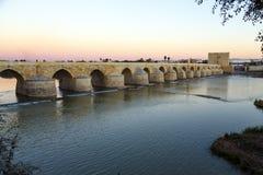Sunset in the Roman bridge as it passes through the river Guadalquivir in Cordoba Royalty Free Stock Photos