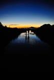 Sunset Romantic. Romantic couple walking on a stream at sunset vector illustration