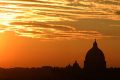 Sunset rome skyline. Beautiful colors in Rome at sunset with the Saint Peter Basilica silhouette Stock Images