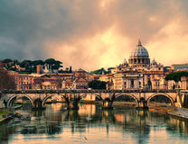 Sunset in Rome. View of the Vatican at sunset with bridges over the Tiber river in Rome, Italy. HDR image stock image