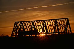 Sunset and roof trusses Royalty Free Stock Photos