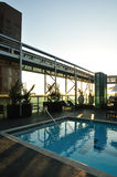 Sunset rooftop pool Royalty Free Stock Images