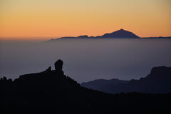 Sunset on Roque Nublo & Teide Stock Photos