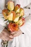 Sunset Roses Bridal. Natural bride holding a sweet, elegant, eco-friendly bouquet stock image