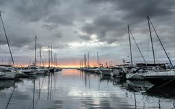 Sunset in Roses leisure port , Costa Brava, Catalonia stock photography