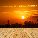 Sunset rosy clouds and wooden platforms Royalty Free Stock Image