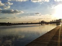Sunset at royal Albert docks. Clear, calm waters of the royal Albert docks at sunset Stock Photo
