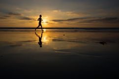 Sunset Runner. Runner on the beach at sunset Royalty Free Stock Images
