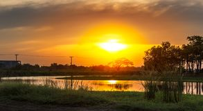 Sunset at rural scene. Beautiful sunset or sunrise with pond on rural scene Royalty Free Stock Photos