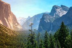 Sunset's golden light moves across Yosemite Valley's waterfalls Stock Image