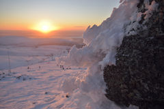 Sunset's reflection on a snow. Sunset in mountains on a north Royalty Free Stock Photo
